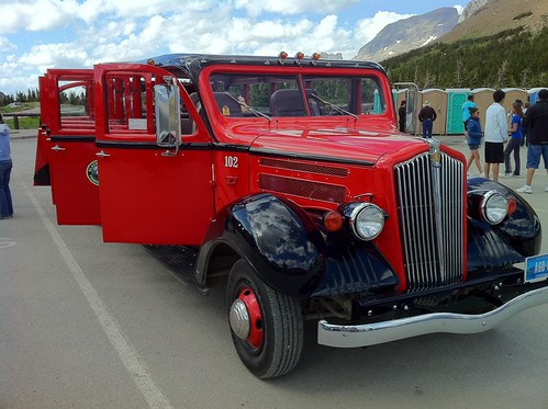 "Red ""Jammer"" bus in Glacier National Park"
