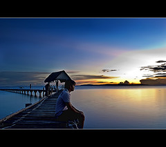 the pleasure.. of being one with the nature (PNike (Prashanth Naik)) Tags: blue sunset sea sky water island lights pier nikon asia philippines hour sunburst selfie nalusuan d3000 pnike