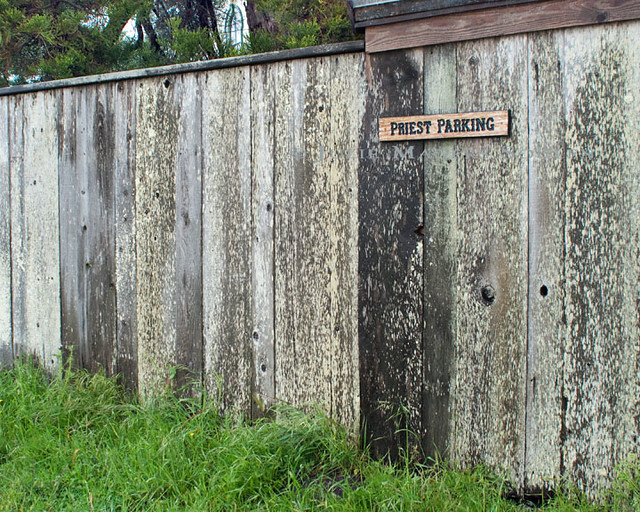 A rustic gray weathered wooden fence with a
