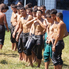 Getting ready out on Sarayici Field (CharlesFred) Tags: turkey wrestling turkiye oil kirkpinar edirne oilwrestling trakya oilwrestler sarayicifield pehlivanguresi