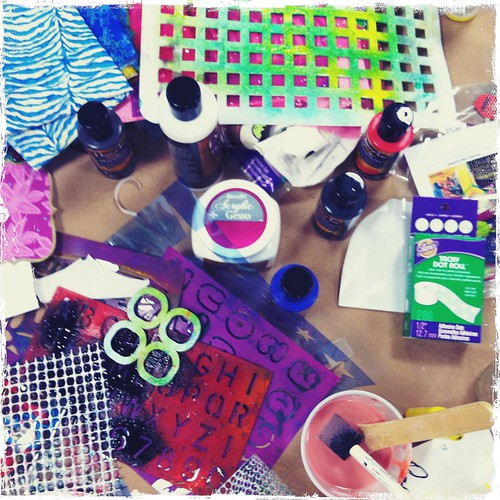 a table full of mixed media goodies at my artJOURNALING daily workshop