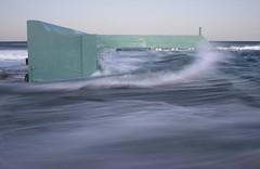 Grandstand (pominoz) Tags: sea newcastle waves dusk tide nsw swell oceanbaths newcastleoceanbaths