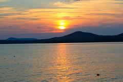 Maine summer sunset (MaineIslandGirl) Tags: light sunset summer usa lighthouse point island coast maine july islesboro 2011 grindle