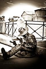 Cow Boy in the City (inchiostratore05) Tags: cowboy cow boy boys roma rome x metal iron metallo pistola pistole gun toy siesta pausa rest repose break city città black white bianco e nero light sitting sky metallized inchiostratore nikon d60 italy italia hat far west artist artista di strada street house home edifici corso passeggio intrattenitore mimo mime artisti
