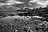 Ibiza Town Lighthouse - Black and White (capturedcanvas.co.uk) Tags: travel chris sea blackandwhite lighthouse white seascape black art beach water monochrome clouds reflections landscape photography mono rocks moody captured scenic smith canvas ibiza lightroom 450d canon450d