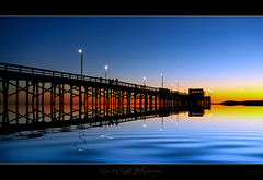 Newport North Side (Tony DeSantis Photography) Tags: ocean blue sunset sky reflection yellow night canon pier pacific time sigma newportbeach explore socal nik southerncalifornia orangecounty 1020mm oc sigma1020mm colorefexpro30 topazadjust tonydesantisphotography topazinfocus tonydphotoblog stunningphotogpin