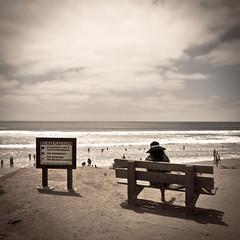 Beach View (Siobhn Bermingham) Tags: california summer sky woman cloud signs beach hat june bench sand sandiego delmar 2011