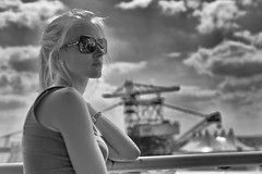 girl in ferropolis (Winfried Veil) Tags: leica party portrait blackandwhite bw music reflection industry girl sunglasses festival clouds 50mm kohle dof bokeh profile wolken rangefinder portrt depthoffield blond sw melt musik coal reflexion industrie spiegelung summilux asph mdchen sonnenbrille ferropolis profil tagebau m9 schrfentiefe mirroring coalmining braunkohle 2011 bucketwheel tiefenschrfe unschrfe schwarzweis grfenhainichen schaufelradbagger braunkohletagebau bucketwheelexcavator surfacemining meltfestival opencastmining messsucher mobilew leicam9 winfriedveil