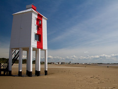 Burnham-On-Sea Lighthouse (Mukumbura) Tags: wood uk travel blue light red vacation england sky lighthouse white holiday beach stairs walking outdoors coast town wooden sand lighthouses flat mud legs unitedkingdom dunes somerset landmark icon safety iconic mudflats navigation piles burnhamonsea quicksand 1832 lighthouseonlegs summertimeuk