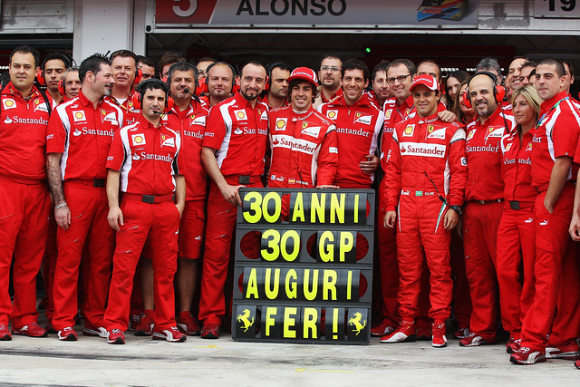 The Scuderia Ferrari team celebrating Fernando Alondo's 30th birthday and also his 30th Grand Prix with Scuderia Ferrari - the 2011 Hungarian Grand Prix