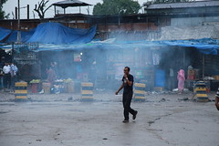 Smoke (Sunanda Chandry Koning) Tags: street morning travel blue nepal white man black color silhouette digital canon photography eos early photo asia market smoke picture 5d kathmandu nepali markii 2011 buspark canoneos5dmarkii june2011 canon5dmarkii