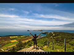 Discovering Jeju Island (Shabbir Ferdous) Tags: ocean travel blue sky cloud mist color colour green fog island photography photographer shot south picture korea jeju province jejudo honeymoonisland bangladeshi cheju ef1635mmf28liiusm shabbirferdous wwwshabbirferdouscom shabbirferdouscom hawaiiofkorea landscapecanoneos1dmarkiv