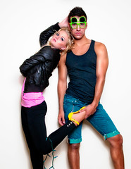 Neon Pop (Stephanie Wesolowski) Tags: christmas pink blue portrait people white black hot male guy green colors girl face leather fashion yellow wall shirt female digital photoshop pose lights glasses nikon colorful paint neon jean bright muscle ripped style indoor jacket blonde tanktop heels denim shorts grainy retouch softbox strobe leggings stilettos flipped