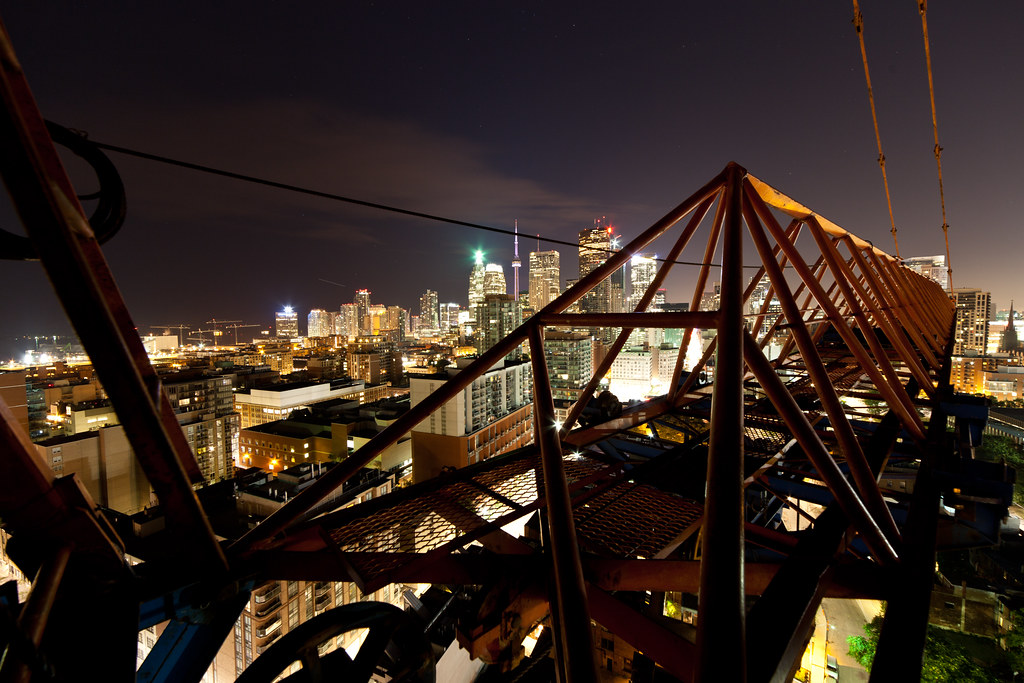 skyline view of toronto at night as seen from a construction site crane