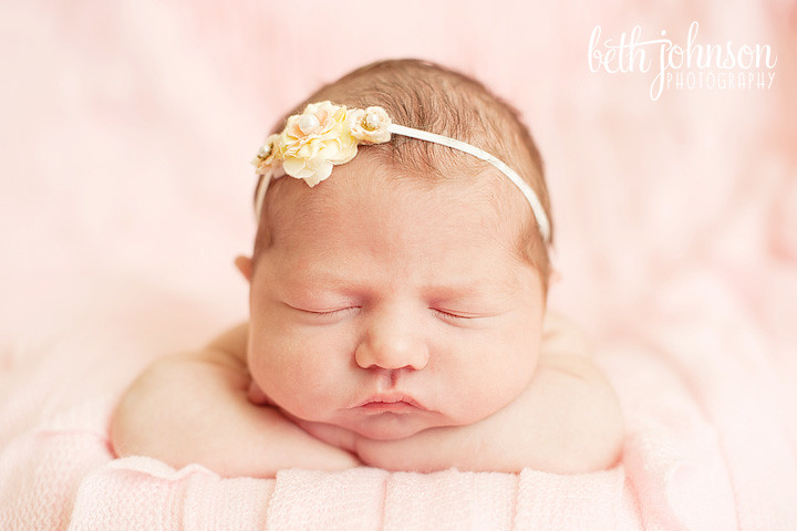 newborn baby girl in tallahassee on pink blanket