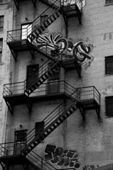 (ChongoIsDanegerous) Tags: old city urban blackandwhite bw white black building brick art metal architecture fire photography graffiti photo blackwhite paint image tag picture pic photograph vandal vandalism fireescape dane exit fireexit hillard danehillard nikond7000