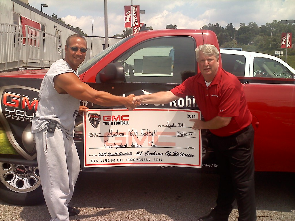#1 Cochran GMC's Dale Taylor presenting $500 check to MLS league president, Rob Macek