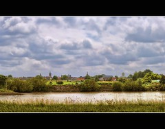 View at Vianen (Wim Koopman) Tags: city sky holland tree green church water netherlands dutch grass clouds river photography photo nikon cityscape view watertower stock nederland meadow churchtower rijn lek stockphoto vianen stockphotography d90 wpk