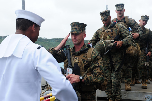 Marines with the 31st MEU board the USS Essex at White Beach Naval Facility Okinawa