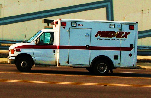 A close up shot of a westbound Ambulance on Grand Avenue.  Elmwood Park Illinois USA. June 2011. by Eddie from Chicago
