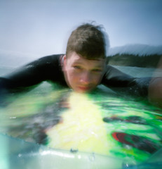 Me on a board, pt.1 (of 1) (Zeb Andrews) Tags: ocean film me oregon square coast surfing pinhole surfboard pacificnorthwest selfpotrait zero2000 wetsuit zeroimage shortsands bluemooncamera woodencameras orshortysasitisknown