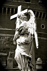 Angel with a Cross, Ponte Sant'Angelo, Rome (Alex E. Proimos) Tags: bridge bw italy sculpture white black rome roma angel wings dress cross ponte campo angelo sant ercole carrying santangelo ferrata pons marzio aelius ercoleferrata aelian proimos