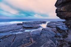 Exposed (James.Breeze) Tags: ocean longexposure seascape beach water rock sunrise landscape sandstone waves seascapes cloudy australia cliffs breeze reef saltwater northernbeaches whalebeach beachsunrise devilscauldron bestofaustralia jamesbreeze ef14mmf28liiusm