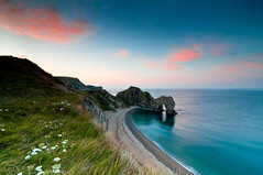 Durdle Door Sunrise (Kevin_Mitchell) Tags: ocean morning sea england up clouds sunrise landscape early nikon long exposure wake arch colours photographer natural united year dream like kingdom calm atlantic hues lee harmony serenity dorset reality dreamy serene filters puffy f4 entry pinks 1635 d300 durdledoor beauitful nothdr jurasiccoast anawesomeshot