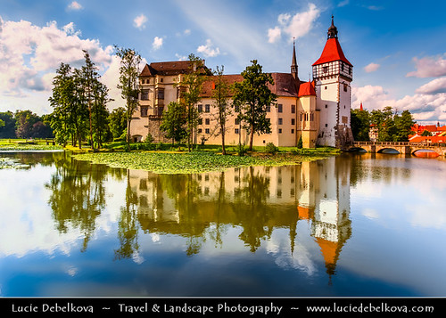 Czech Republic - Blatna Water Castle - Zamek Blatna reflected in the surrounding lake during sunny summer day