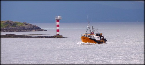 Passing the lighthouse by Ginas Pics