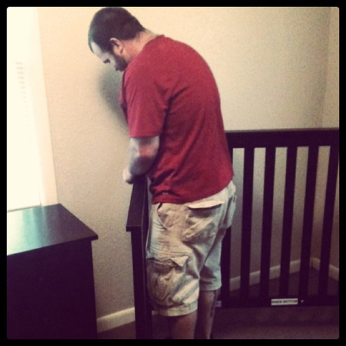Hubby putting the crib together!