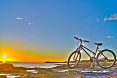 In the Morning (Fayth89) Tags: morning blue sky orange sun beach water bike bicycle photoshop sunrise shine rise