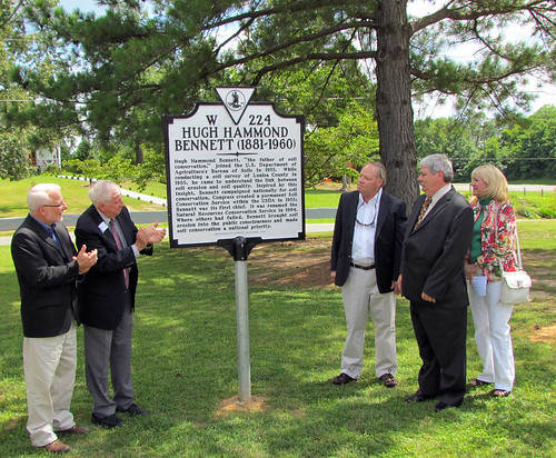 NRCS Chief Dave White and Dr. Maurice Cook applaud as Hugh Hammond Bennett, III, his wife Nina Bennett, and his brother, Robert Bennett view the newly unveiled historical marker.