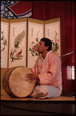 Puk (Barrel Drum) Player at P'ansori Performance, Seattle (Washington State Folk Arts) Tags: drums musicalinstruments storytellers narrators verbalartsandliterature koreanpansoriperformers