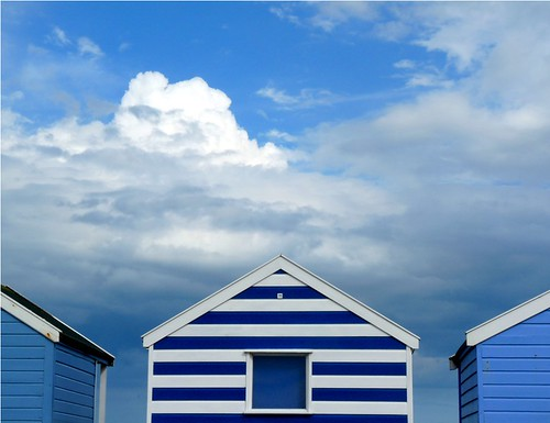 Beach huts in blue by PhotoPuddle