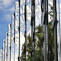 Swirl (Arni J.M.) Tags: trees sky reflection building glass architecture clouds mirror switzerland zug citygardenhotel