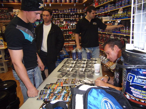 Rich signing autograph for fan in Levis Popeye store