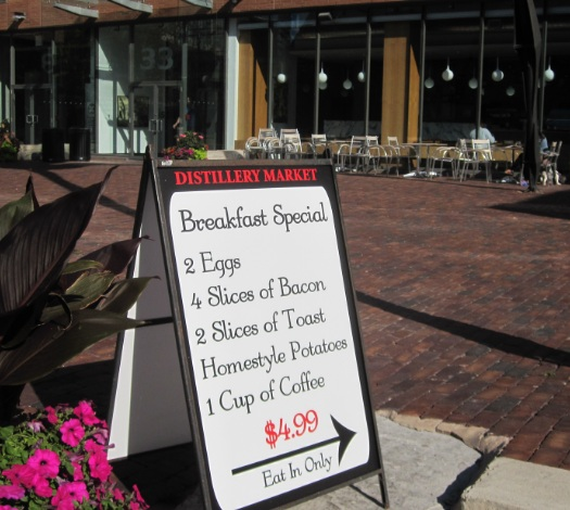 sign that advertises breakfast special at the distillery market