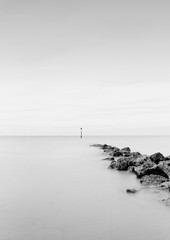 Experimental minimalism (Anthony Owen-Jones) Tags: ocean uk longexposure sea blackandwhite bw white black beach water monochrome wales night canon lens landscape eos rebel mono bay coast landscapes photo twilight kiss rocks europe exposure unitedkingdom horizon gimp minimal filter photograph nd getty kit minimalist bnw conwy hoya t3i x5 rhosonsea colwynbay northwales rhos colwyn 600d takenwith nd16 canonefs1855mmf3556is clpl rebelt3i kissx5