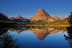 Mountain Medicine (Phil's Pixels) Tags: sunrise reflections dawn mirror montana glaciernationalpark twomedicine praylake mtsinopah paintedteepeemountain