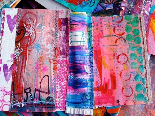 stitching bits and pieces of fabric & papers