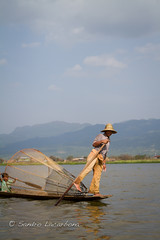On the Inle lake (Sandro_Lacarbona) Tags: voyage trip travel lake fish man hat boat burma paddle lac chapeau myanmar inle bateau backpacker sandro rame homme routard tourdumonde pcher tetedechatcom lacarbona