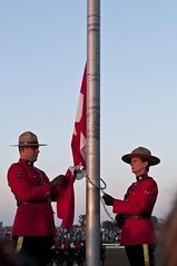 Lowering the Flag (Tawaw) Tags: horses canada flag ottawa police rcmp equestrian stetson mounties mountedpolice royalcanadianmountedpolice policehorses musicalride redserge canadianpolicecollege