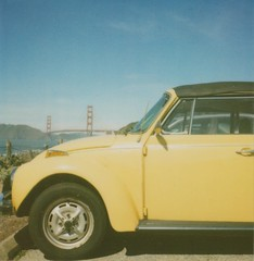 punch bug yellow (jodi*mckee) Tags: sanfrancisco california vw bug polaroid sx70 beetle goldengatebridge bakerbeach 600film roidweek2011