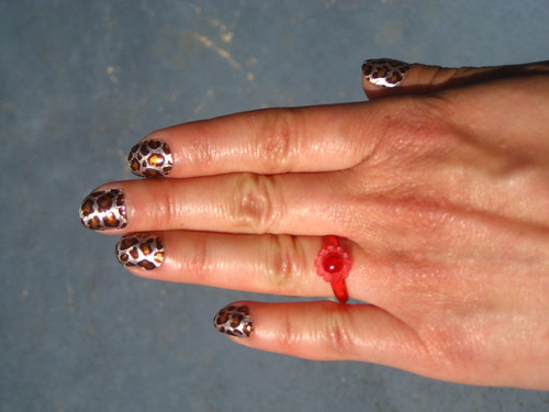 leopard nails with ruby ring