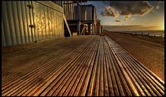 Boardwalk (J.W.Turner) Tags: ocean wood blue sunset sea sky beach water lines clouds canon evening coast kent sand board tokina hut groove plank 1224 500d swalecliffe
