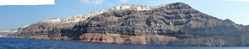 Cliffs on the southern side of Therasia, Santorini, showing several lava flows from the Therasia Shield phase of the volcano (55,000-22,000 years ago). Also note the white Minoan deposits on top, from the eruption 3,600 years ago.