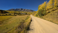 On the Road to Fall (Fort Photo) Tags: road fall nature rural landscape vanishingpoint nikon colorado path country lane co dirtroad aspen pathway d300 twotrack converginglines ohiopass