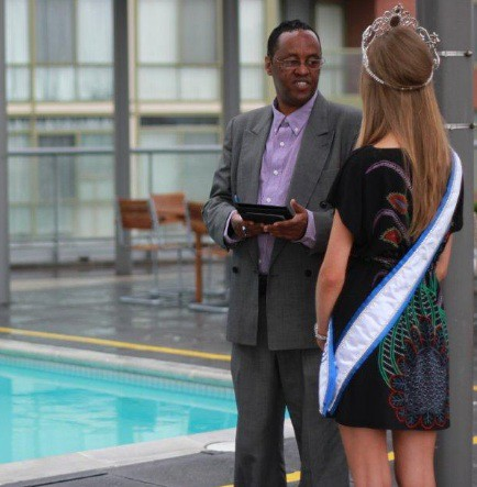 Farid Omar with Miss Teen Canada World 2011 Lauren Howe near the pool area of 33 Mill St, Pure Spirits Condominium in Toronto