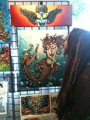 Art wall at Portland Saturday Market (lucidRose) Tags: paint acrylic goddess canvas faery etsy mermaid fae giclee portlandsaturdaymarket chelsearose lucidopticlab faeguide